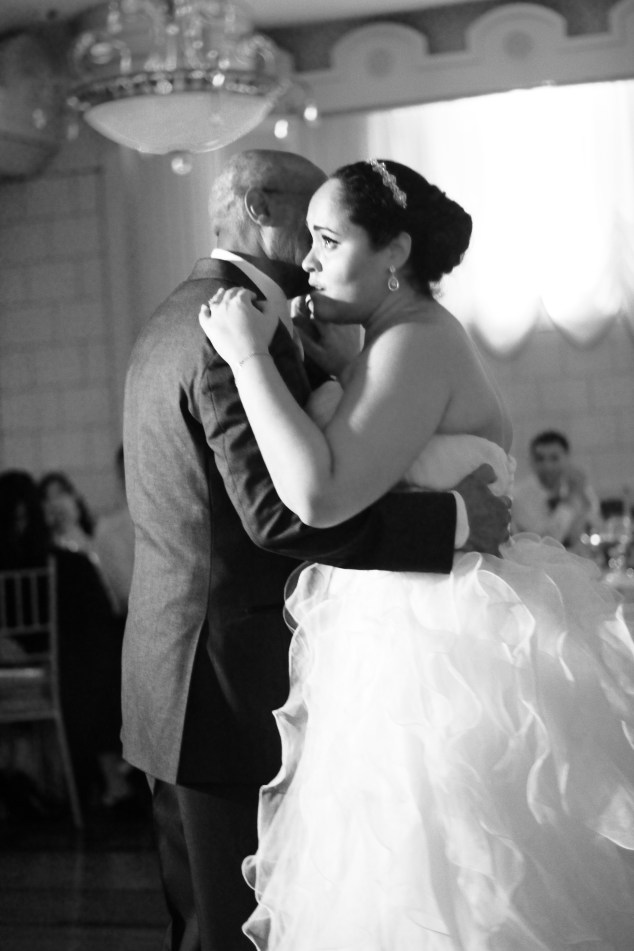Joi dancing with her father.